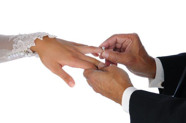 ejbigstock-Closeup-of-the-groom-placing-a-39640351